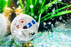 Mechanical water meter. The device immersed in water for a beautiful demonstration of the goods to the buyer