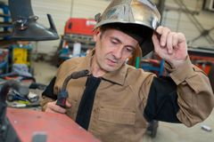 Mechanical welder inspecting material Royalty Free Stock Photography
