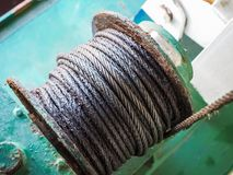 A mechanical Winch. On the green Floor Royalty Free Stock Photos