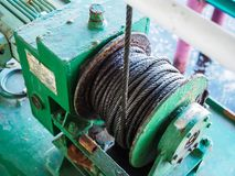Mechanical Winch. A green mechanical Winch on the green Floor Stock Photos
