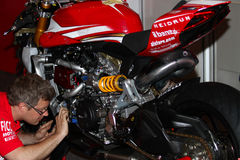 Mechanical working on Ducati 1199 Panigale R Team Ducati Alstare Superbike WSBK stock image