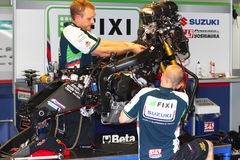 Mechanical working on Suzuki GSX-R1000 Team Fixi Crescent Suzuki Superbike WSBK royalty free stock image