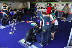 Mechanical working on Suzuki GSX-R1000 Team Fixi Crescent Suzuki Superbike WSBK stock image