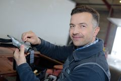 Mechanician at work in auto repair garage Royalty Free Stock Photo