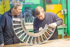 Mechanics assembles parts for aviation engine Stock Photography