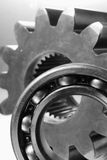 Mechanics in black/white. Detail of ball-bearing in front of gear-wheel Royalty Free Stock Photo