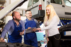 Mechanics calculating repairs cost Stock Image