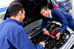 Mechanics at a car garage Royalty Free Stock Images