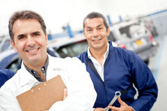 Mechanics at a car garage Stock Photography