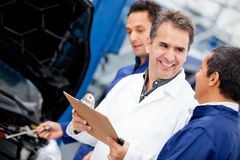Mechanics at a car garage Royalty Free Stock Photography