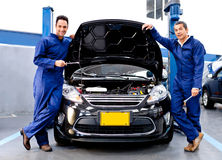 Mechanics at a car repair shop Stock Photography