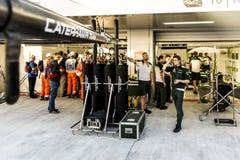 Mechanics Caterham F1 Team in their boxes. Stock Photos