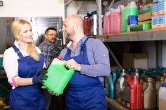 Mechanics choosing antifreeze liquid Royalty Free Stock Photo