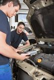 Mechanics with Diagnostic Equipment Royalty Free Stock Photo