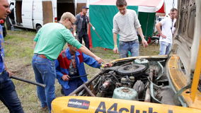 The mechanics eliminate the damage to the car during the fight stock video