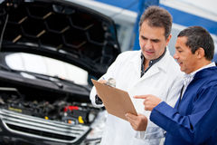 Mechanics fixing a car Stock Image