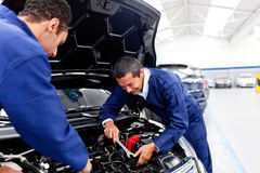 Mechanics fixing a car Royalty Free Stock Image