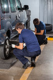 Mechanics Fixing Car Tires Royalty Free Stock Photo