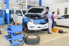 Mechanics fixing car Stock Photography