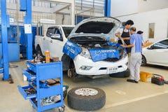 Mechanics fixing car stock images