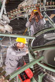 Mechanics fixing loom Stock Images