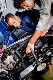 Mechanics in a garage Royalty Free Stock Image