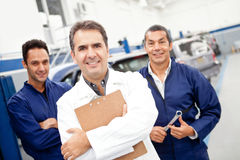 Mechanics at a garage Royalty Free Stock Images