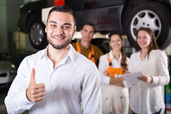 Mechanics and happy customer Stock Photos