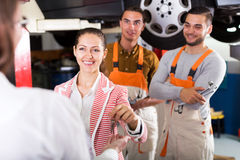 Mechanics and happy customer Royalty Free Stock Images