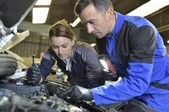 Mechanics instructor teaching apprentice Royalty Free Stock Photos