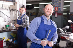 Mechanics in a motocycle repair shop Royalty Free Stock Images