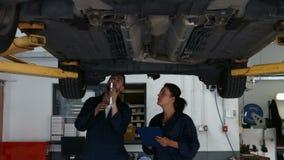 Mechanics overhauling a car stock video footage