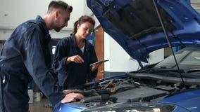 Mechanics overhauling an engine stock footage
