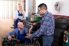 Mechanics rebuilding engines Stock Photos