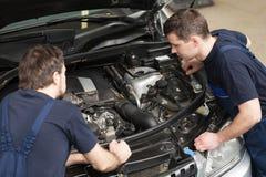 Mechanics at repair shop. Royalty Free Stock Photos