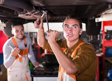 Mechanics repairing car of client Royalty Free Stock Image