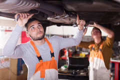Mechanics repairing car of client Royalty Free Stock Images