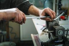 Mechanics repairing a diesel injector. Royalty Free Stock Photos