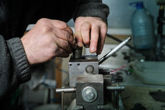 Mechanics repairing a diesel injector. Stock Photos