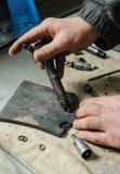 Mechanics repairing a diesel injector. Stock Photo