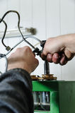 Mechanics a repairing a diesel injector. Royalty Free Stock Image