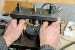 Mechanics a repairing diesel injector. Royalty Free Stock Images