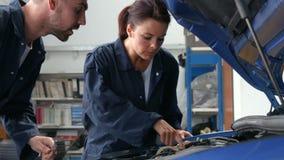 Mechanics repairing an engine stock video footage