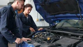 Mechanics repairing an engine stock footage