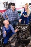 Mechanics repairing engines Royalty Free Stock Photo