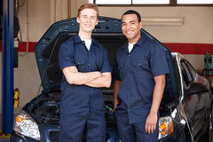 Mechanics standing in front of car royalty free stock photos