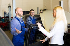 Mechanics taking car for service Stock Images