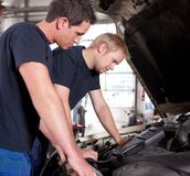 Mechanics Team with Diagnostics Equipment Royalty Free Stock Photography
