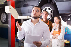 Mechanics trying to cheat client Stock Photography