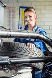 Mechanics Using Digital Tablet In Car At Garage royalty free stock photography